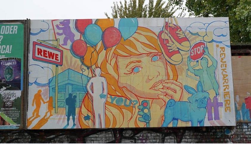 Außenwerbung - REWE mit Graffiti für die Ausbildung